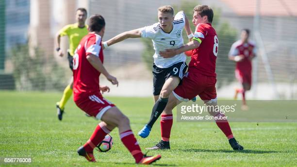 Arsen Yeghiazaryan of Armenia challenges JannFiete Arp of Germany during the UEFA U17 elite round match between Germany and Armenia on March 23 2017...