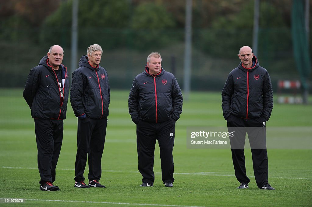 Arsenal 1st team coach Boro Primorac, manager <a gi-track='captionPersonalityLinkClicked' href=/galleries/search?phrase=Arsene+Wenger&family=editorial&specificpeople=171184 ng-click='$event.stopPropagation()'>Arsene Wenger</a>, 1st team coach Neil Banfield and assistant manager Steve Bould look on during a training session at London Colney on October 29, 2012 in St Albans, England.