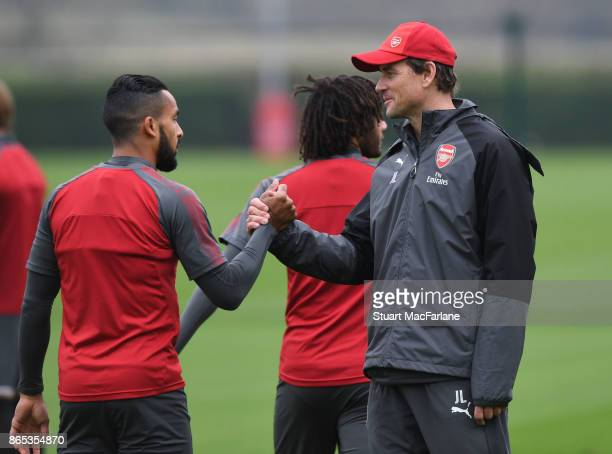 Arsenal 1st team coach Jens Lehmann with Theo Walcott during a training session at London Colney on October 23 2017 in St Albans England