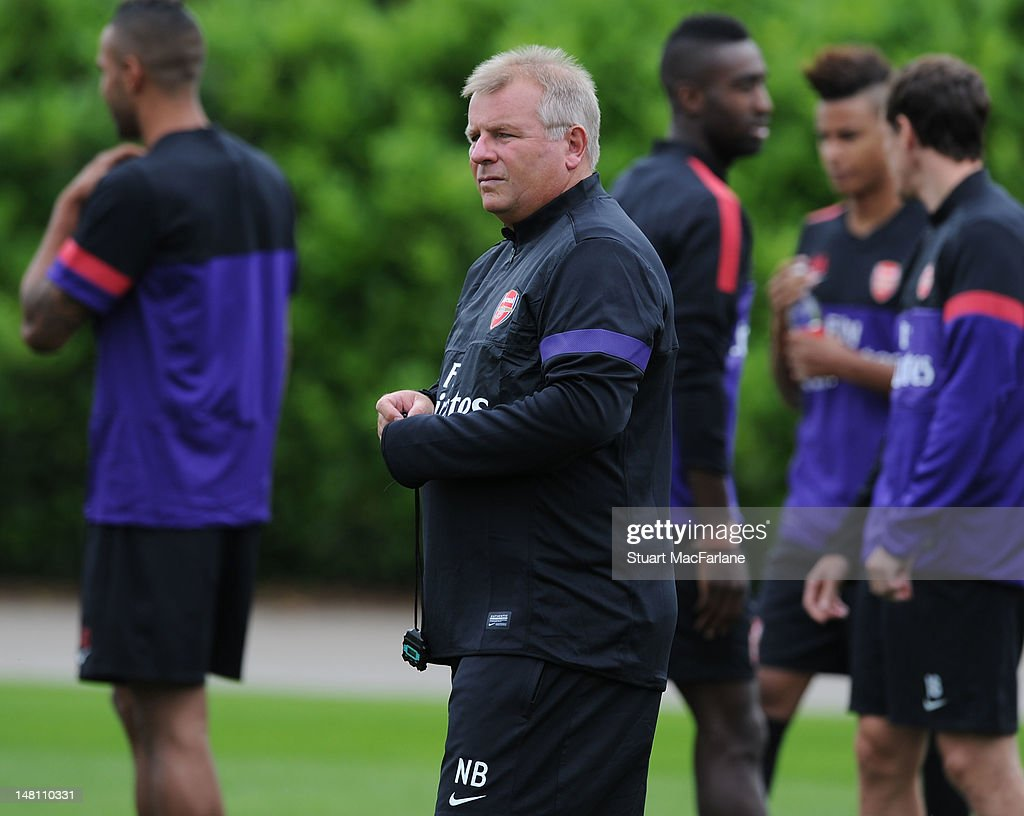 Arsenal 1st team coach Neil Banfield looks on during a training session at London Colney on July 10, 2012 in St Albans, England.