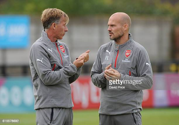 Arsenal Academy Director Andries Jonker chats to Arsenal Youth Coach Freddie Ljungberg before the match between Arsenal and Ludogorets Razgrad in the...