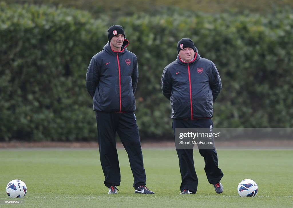 Arsenal assistant manager Steve Bould and 1st team coach Neil Banfield during a training session at London Colney on March 29, 2013 in St Albans, England.