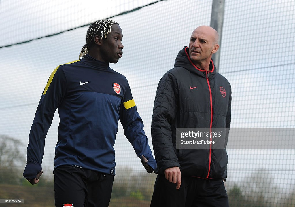 Arsenal assistant manager Steve Bould and Bacary Sagna (L) attend a training session ahead of their UEFA Champions League match against FC Bayern Muenchen at London Colney on February 18, 2013 in St Albans, England.