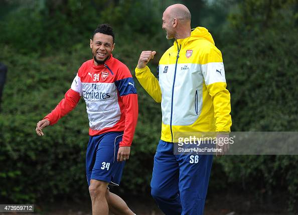 Arsenal Assistant Manager Steve Bould with Francis Coquelin before a training session at London Colney on May 19 2015 in St Albans England