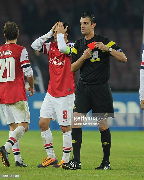 Arsenal captain Mikel Arteta is sent off by referee Viktor Kassai during the match at Stadio San Paolo on December 11 2013 in Naples Italy