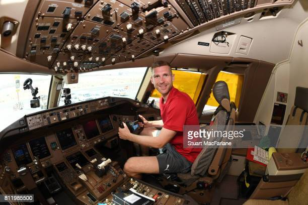 Arsenal captain Per Mertesacker in the cockpit of the team flight to Australia for Arsenal's Pre Season tour at Dubai Airport on July 10 2017 in...