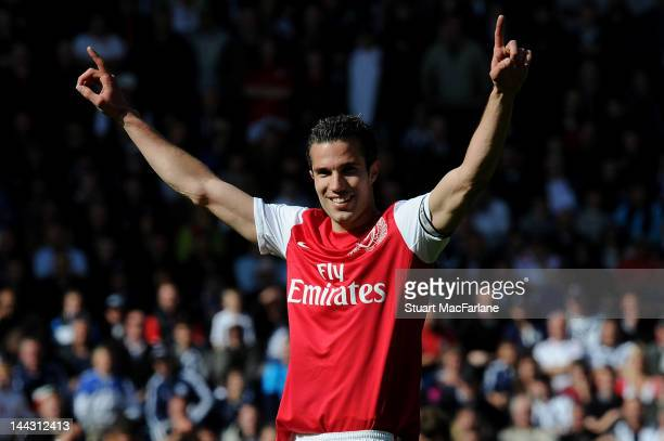 Arsenal captain Robin van Persie celebrates after the Barclays Premier League match between West Bromwich Albion and Arsenal at The Hawthorns on May...