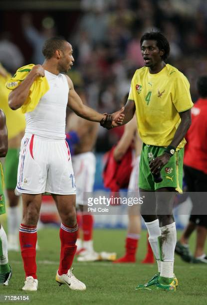 Arsenal captain Thierry Henry of France and Arsenal player Emmanuel Adebayor of Togo speak after the FIFA World Cup Germany 2006 Group G match...
