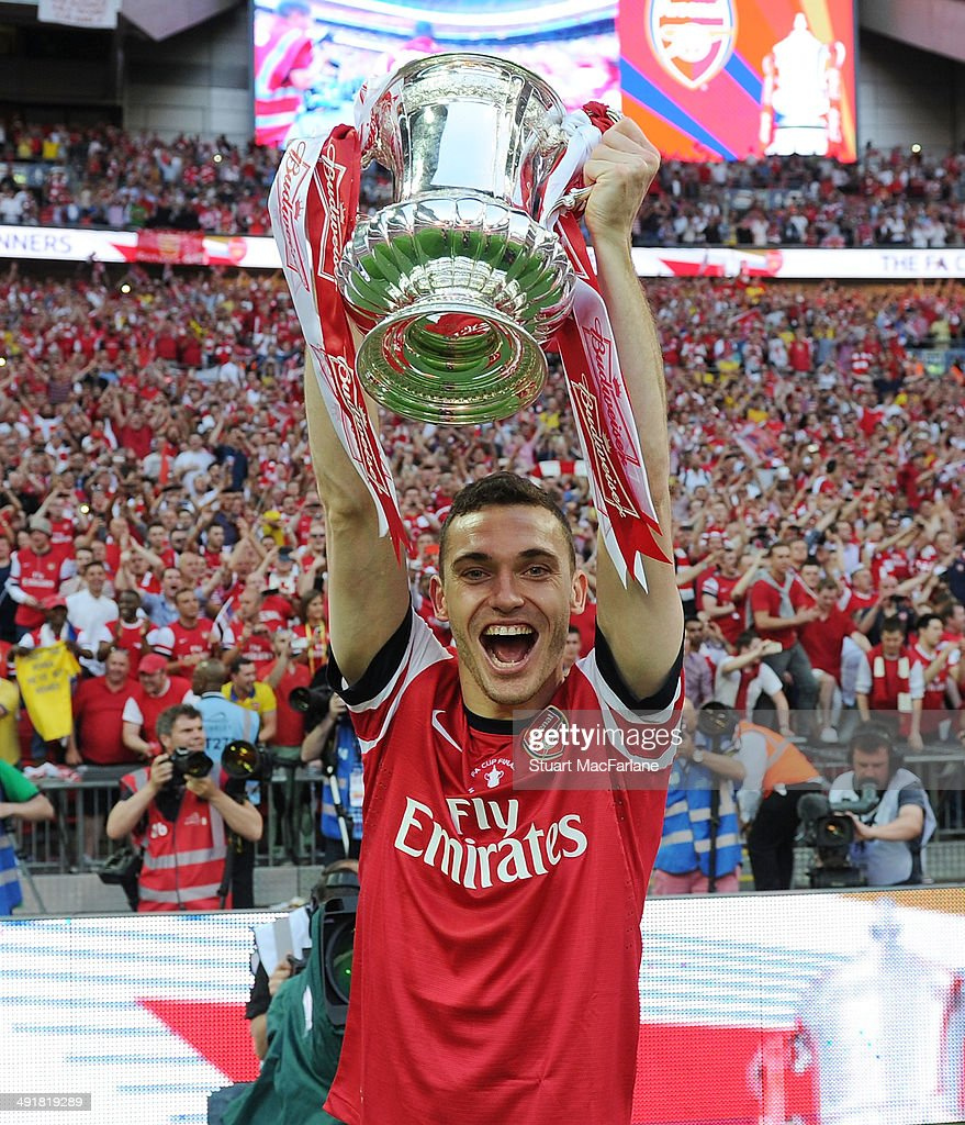 Arsenal captain Thomas Vermaelen celebrates after the FA Cup Final between Arsenal and Hull City at Wembley Stadium on May 17 2014 in London England