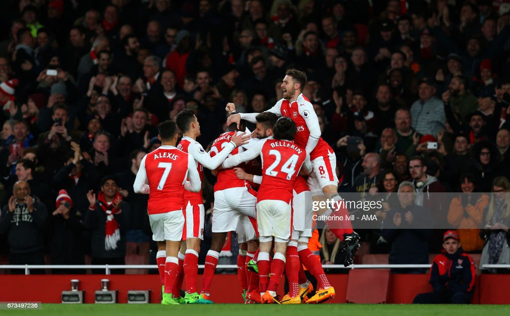 Arsenal celebrate after Nacho Monreal of Arsenal scores to make it 1-0 during the Premier League match between Arsenal and Leicester City at Emirates Stadium on April 26, 2017 in London, England.