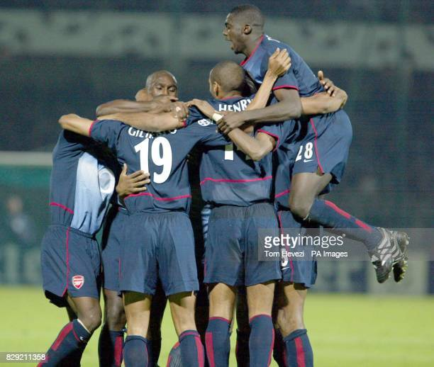 Arsenal celebrate the opening goal against Auxerre during their Champions League Group A match at the Stade Abbe Deschamps Auxerre THIS PICTURE CAN...