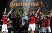 Arsenal celebrate with the trophy after winning the The FA WSL Continental Cup Final match between Arsenal Ladies FC and Lincoln Ladies FC at The...