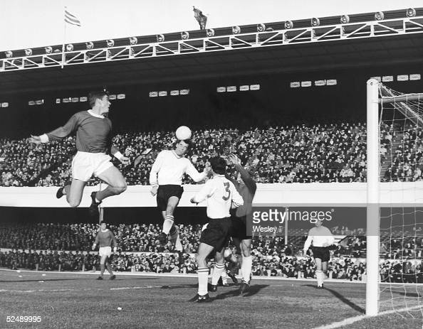 Arsenal centreforward Joe Baker gets his head to the ball before his shot is stopped by Sheffield United goalkeeper Alan Hodgkinson during a match at...