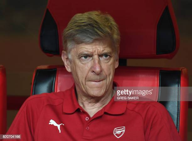 Arsenal coach Arsene Wenger looks on before the start of their preseason football match against Chelsea in Beijing's National stadium known as the...