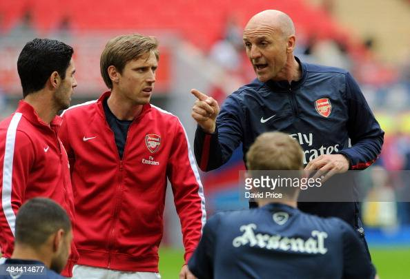 Arsenal Coach Steve Bould chats to Nacho Monreal and Mikel Arteta of Arsenal before during the match between Arsenal and Wigan Athletic in the FA Cup...