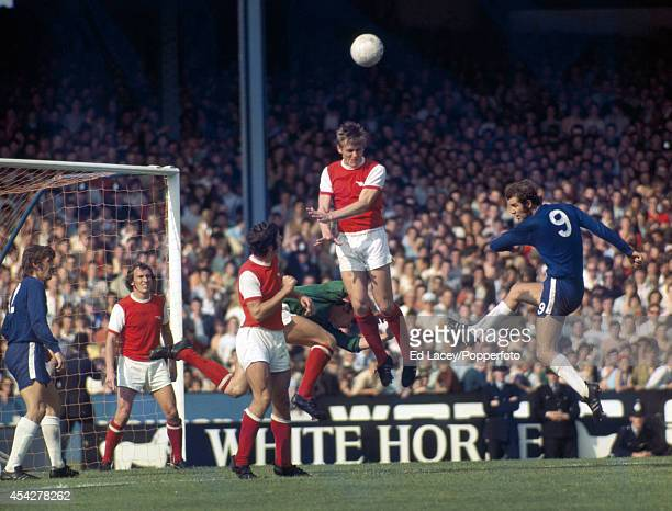 Arsenal defender John Roberts heads the ball away in front of Chelsea striker Peter Osgood during the Division One match at Stamford Bridge in London...