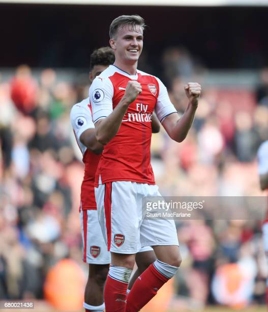 Arsenal defender Rob Holding celebrates after the Premier League match between Arsenal and Manchester United at Emirates Stadium on May 7 2017 in...