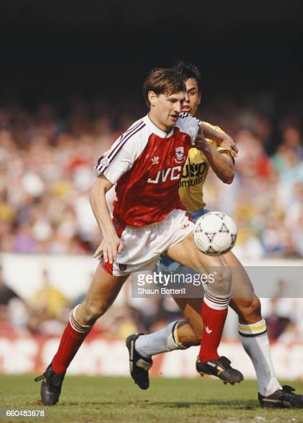 Arsenal defender Tony Adams is challenged by Chris Coleman of Crystal Palace during a Division One match between Arsenal and Crystal Palace at...