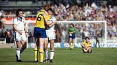 Arsenal defender Willie Young congratulates West Ham United player Paul Allen as Stuart Pearson looks on after West Ham had beaten Arsenal 10 in the...