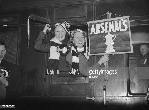 Arsenal F C supporters on the train at Euston Station on their way to support their team in an FA Cup tie against Burnley 20th February 1937