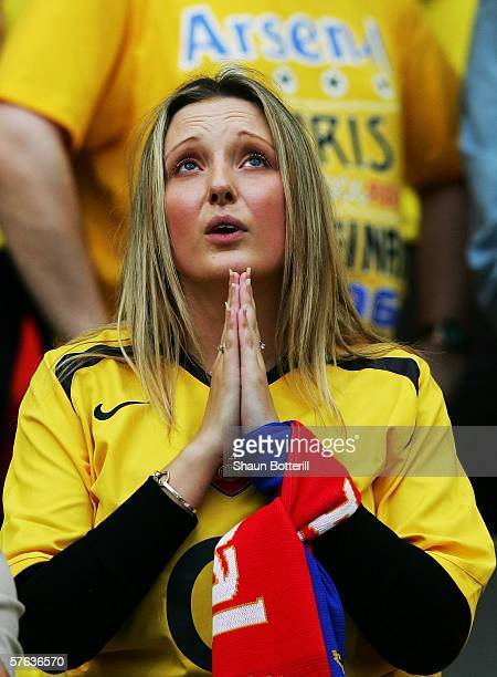 Arsenal fan prays for success for her team before the UEFA Champions League Cup Final between Arsenal and Barcelona at the Stade de France on May 17...