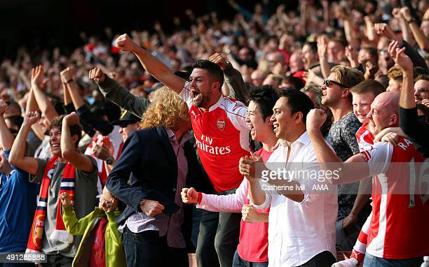 Arsenal fans celebrate after their team take a 20 lead during the Barclays Premier League match between Arsenal and Manchester United at the Emirates...