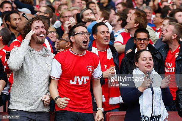 Arsenal fans celebrate as they take a 20 lead in the first half during the Barclays Premier League match between Arsenal and Manchester United at...