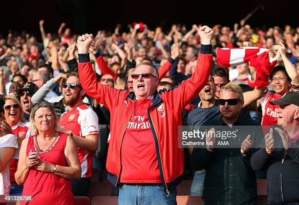 Arsenal fans celebrate during the Barclays Premier League match between Arsenal and Manchester United at the Emirates Stadium on October 04 2015 in...