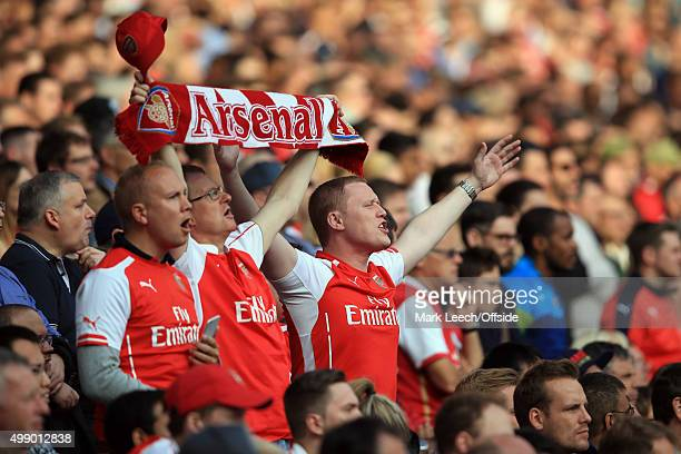 Arsenal fans celebrate during the Barclays Premier League match between Arsenal and Manchester United at Emirates Stadium on October 4 2015 in London...