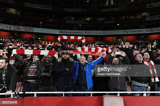 Arsenal fans celebrate during the Barclays Premier League match between Arsenal and Manchester City at Emirates Stadium on December 21 2015 in London