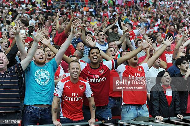 Arsenal fans celebrate during the FA Community Shield match between Arsenal and Manchester City at Wembley Stadium on August 10 2014 in London England