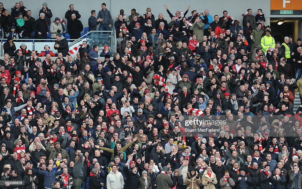 Arsenal fans celebrate the 1st goal, scored by Olivier Giroud during the FA Cup Fourth Round match between Brighton & Hove Albion and Arsenal at the Amex Stadium on January 26, 2013 in Brighton, England.