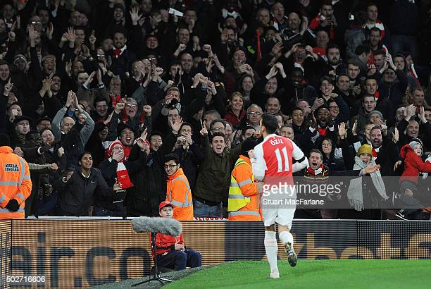 Arsenal fans celebrate the 2nd goal scored by Mesut Ozil during the Barclays Premier League match between Arsenal and AFC Bournemouth at Emirates...