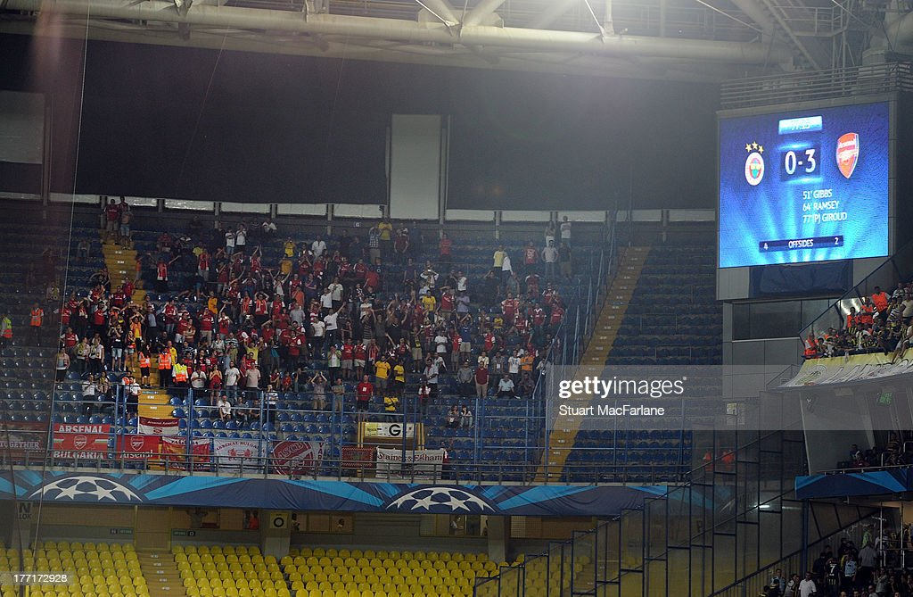 Arsenal fans celebrate the 3rd goal during the UEFA Champions League Play Off first leg match between Fenerbache SK and Arsenal FC at sukru Saracoglu Stadium on August 21, 2013 in Istanbul, Turkey.