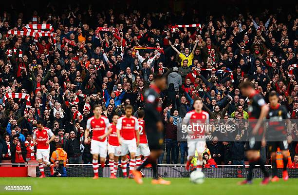 Arsenal fans celebrate the goal scored by Olivier Giroud of Arsenal during the Barclays Premier League match between Arsenal and Liverpool at...