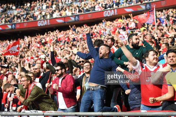 Arsenal fans celebrate their team's second goal during the FA Cup semifinal football match between Arsenal and Manchester City at Wembley stadium in...