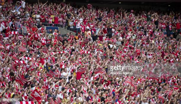 Arsenal fans celebrate their victory against Chelsea FC in the FA Cup final at Wembley Stadium on May 27 2017 in London United Kingdom