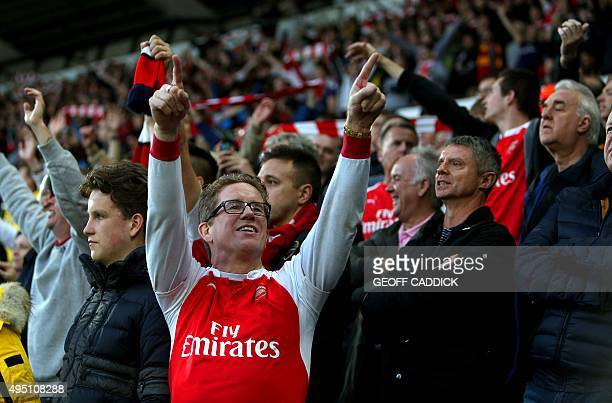 Arsenal fans celebrate their win after the English Premier League football match between Swansea City and Arsenal at The Liberty Stadium in Swansea...