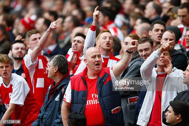 Arsenal fans chant during the Barclays Premier League match between Arsenal and Chelsea at Emirates Stadium on April 26 2015 in London England