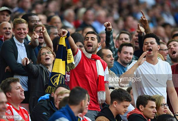 Arsenal fans chant during the Barclays Premier League match between Arsenal and Manchester United at Emirates Stadium on October 4 2015 in London...