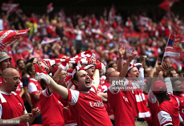 Arsenal fans cheer during the English FA Cup final match between Arsenal and Hull City at Wembly Stadium in London on May 17 2014 USE