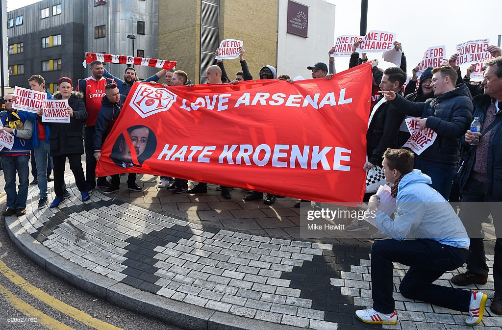 Arsenal fans display a message for owner Stan Kroenke prior to the Barclays Premier League match between Arsenal and Norwich City at The Emirates Stadium on April 30, 2016 in London, England