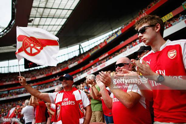 Arsenal fans during the Barclays Premier League match between Arsenal and West Ham United at the Emirates Stadium on August 9 2015 in London England