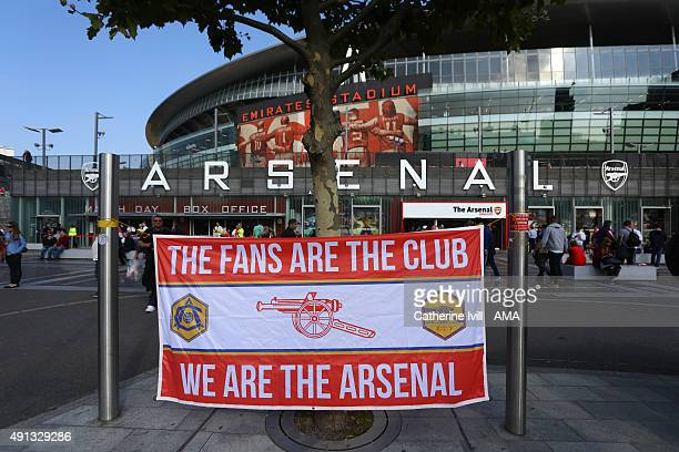 Arsenal fans hang a flag outside stadium saying The fans are the club we are the Arsenal before the Barclays Premier League match between Arsenal and...