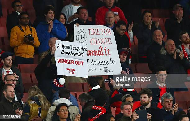 Arsenal fans hold banners after the Barclays Premier League match between Arsenal and West Bromwich Albion at the Emirates Stadium on April 21 2016...