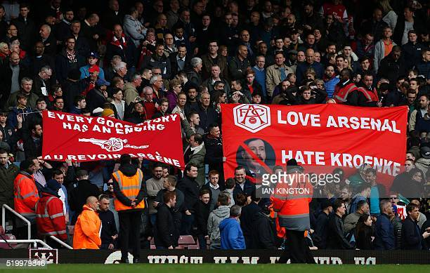Arsenal fans hold banners calling for Arsenal's French manager Arsene Wenger to leave and showing their dislike of Arsenal's US Owner Stan Kroenke...