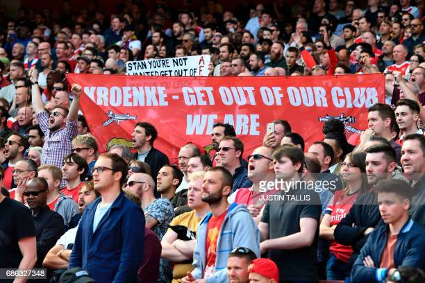Arsenal fans hold up a banner against Arsenal's majority owner Stan Kroenke during the English Premier League football match between Arsenal and...