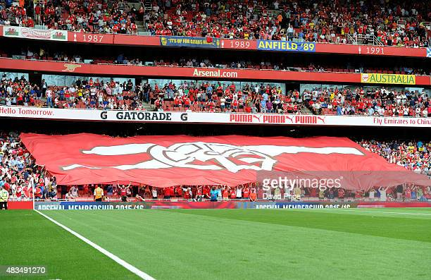 Arsenal fans hold up a banner before the Barclays Premier League match between Arsenal and West Ham United at
