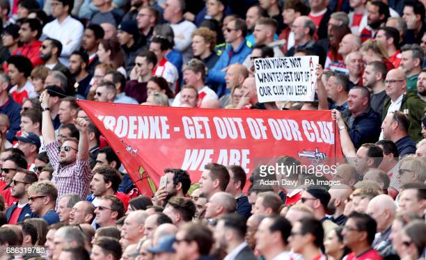 Arsenal fans hold up an antiStan Kroenke banner during the Premier League match at the Emirates Stadium London