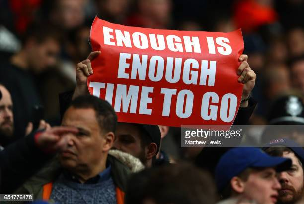 Arsenal fans holds up a poster during the Premier League match between West Bromwich Albion and Arsenal at The Hawthorns on March 18 2017 in West...